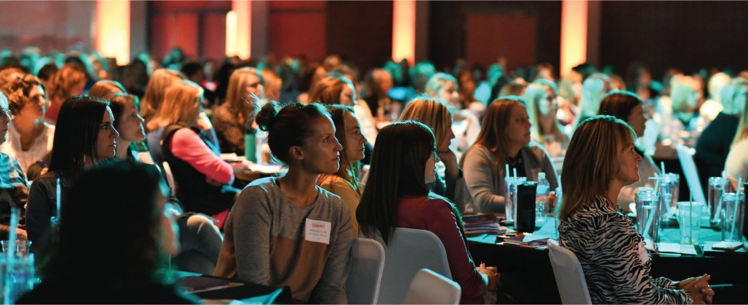 Women watching speaker at summit