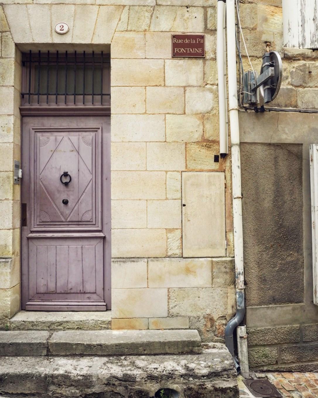 Purple doorway in the village of Saint-Emilion