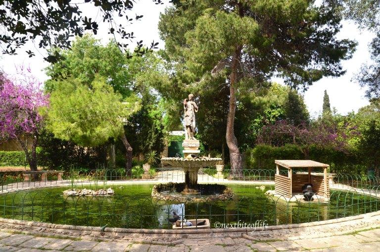 fountain at San Anton gardens Malta with black swan and female statue