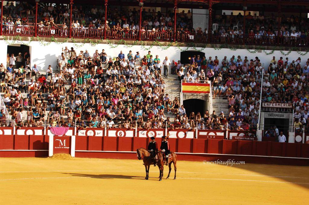 bullfighting arena with horsemen.