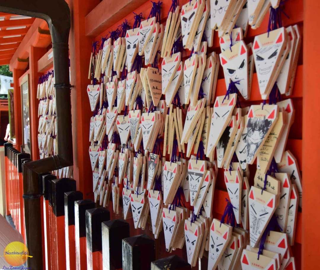 visiting fushimi inari temple fox praying cards