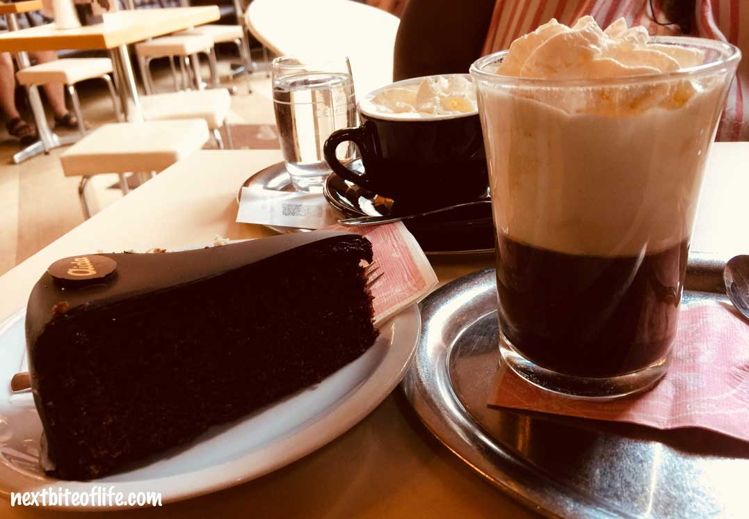 sacher torte and coffee at aida cafe vienna