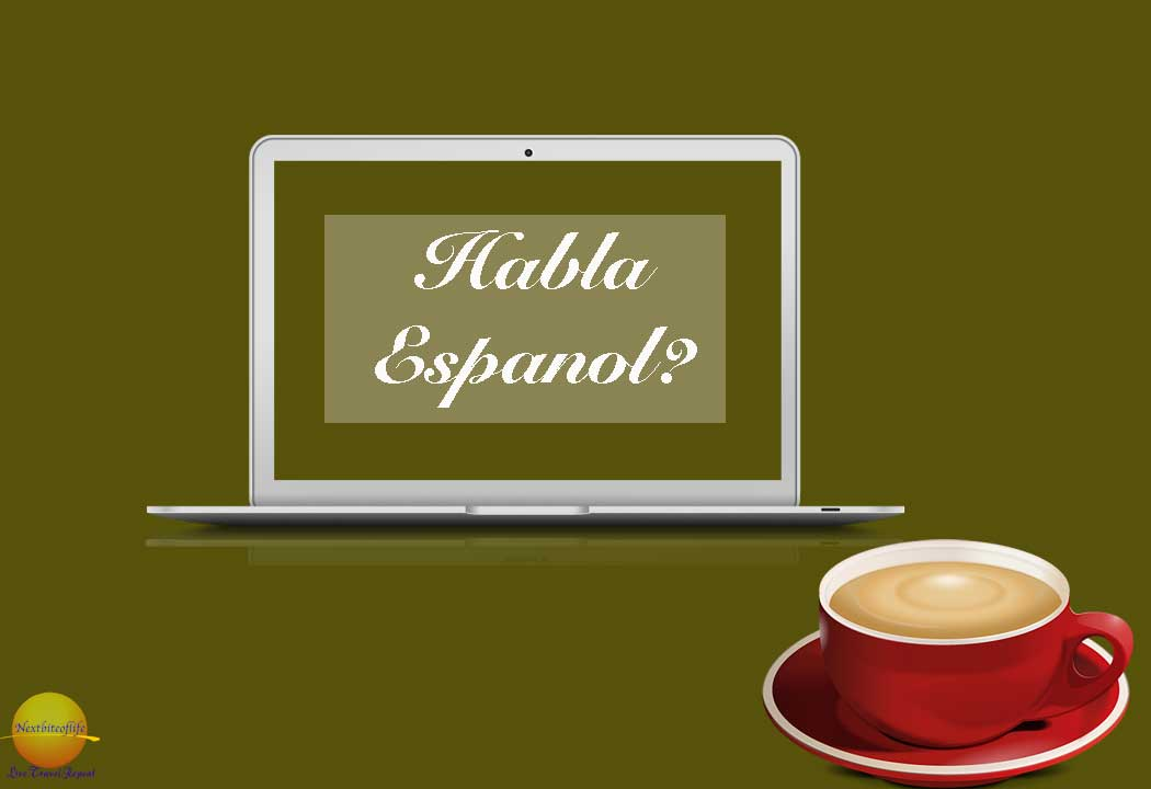 habla espanol on laptop and cup of coffee