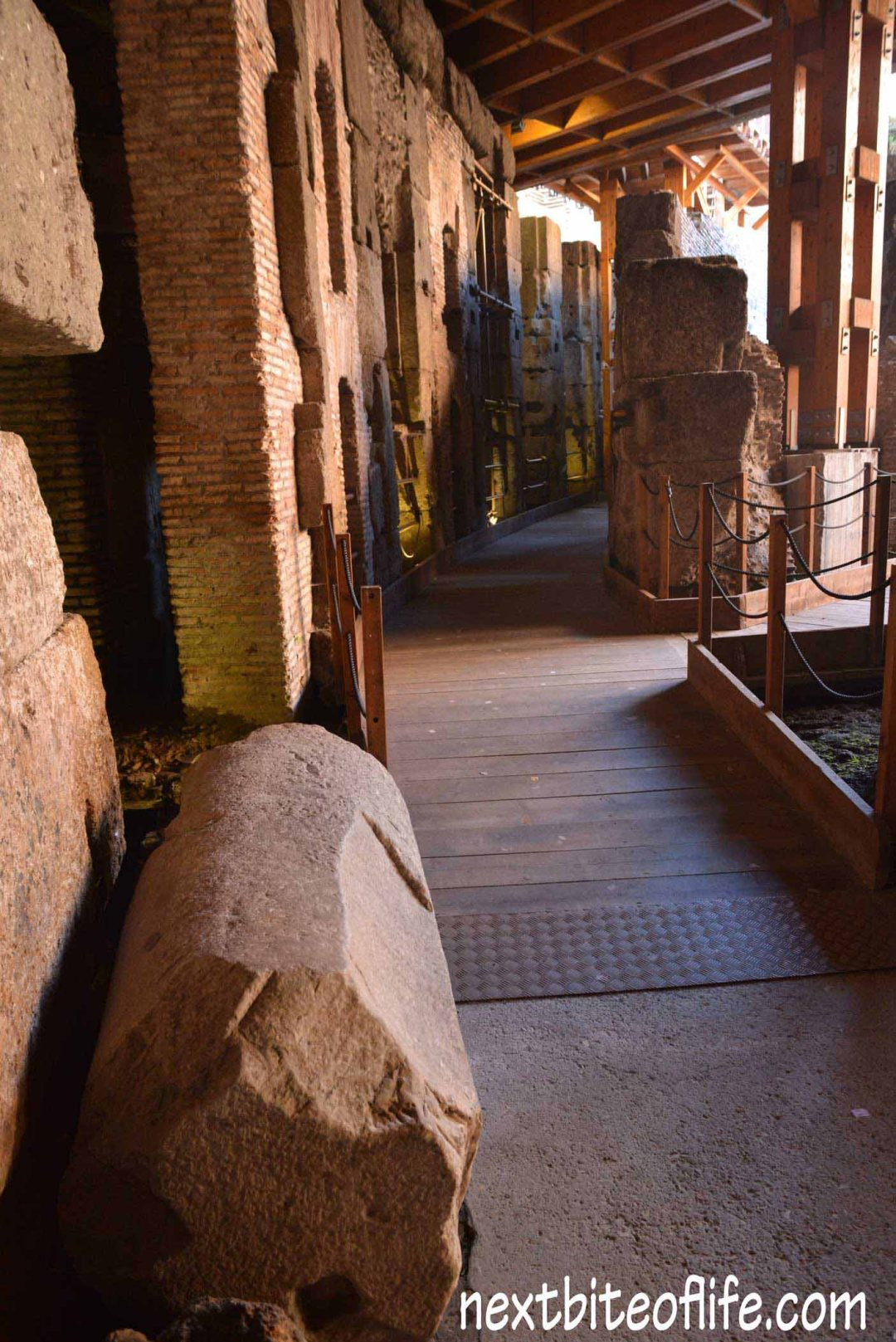 Colosseum Rome underground with columns and pillars