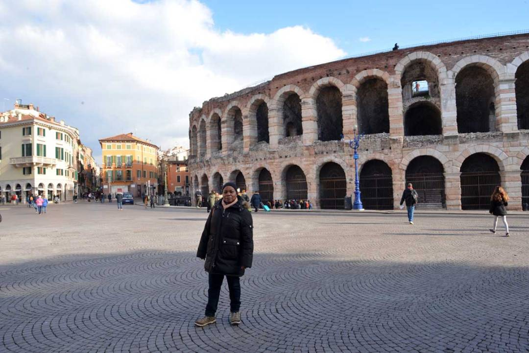 woman standing in front to Verona arena, Italy
