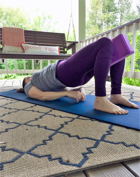 aligned bridge pose with yoga block