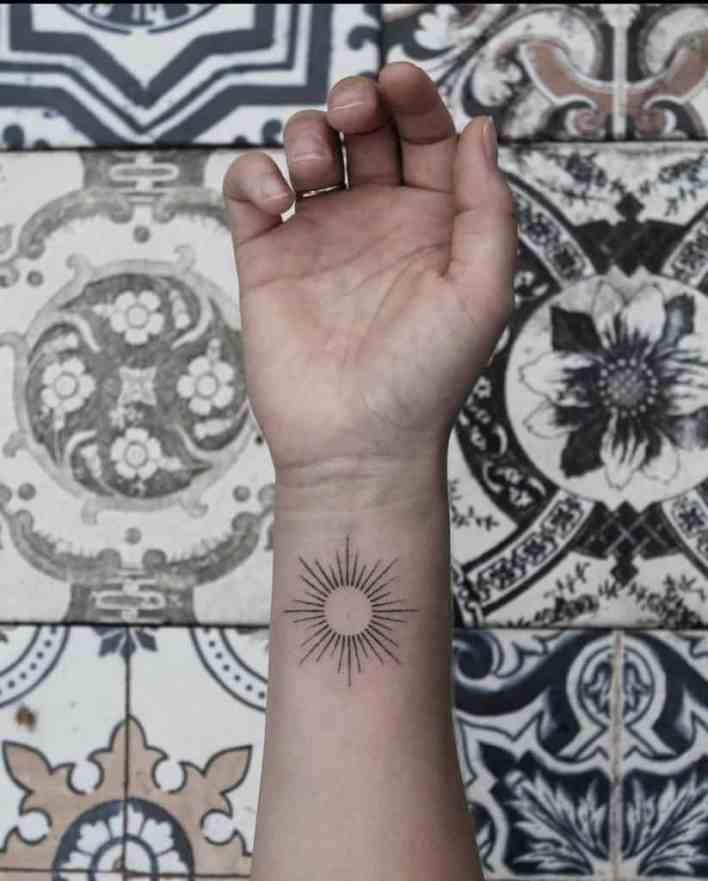 Simple Sun Wrist Tattoo bunkertattoo