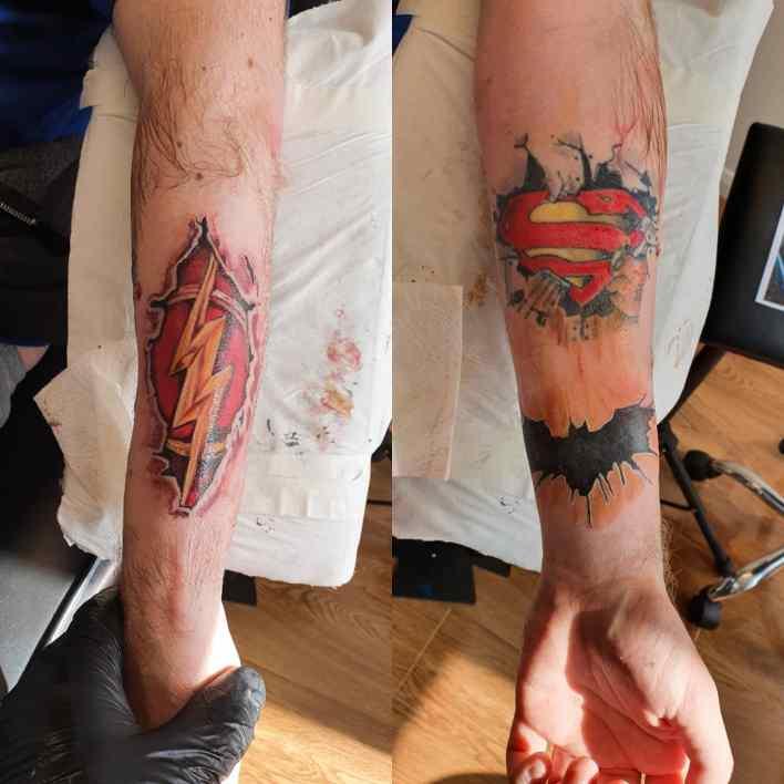 Ripped Skin Superman Tattoo -dabulltattoo