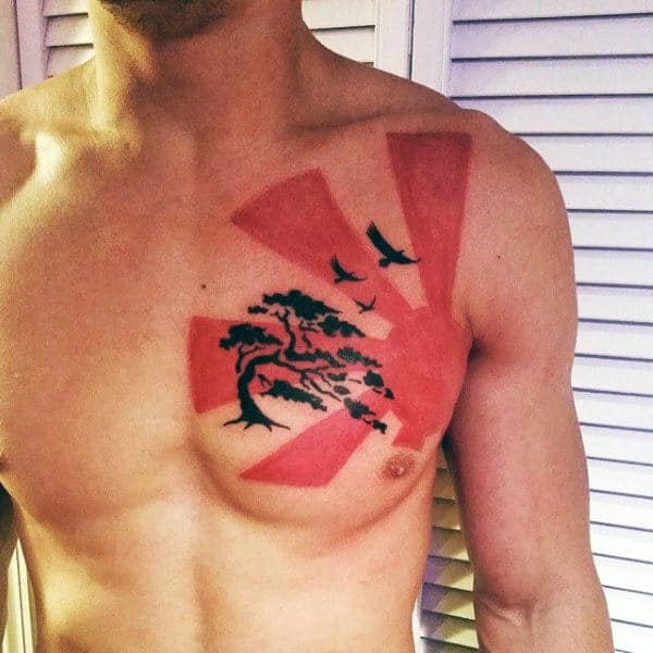 awesome-black-and-red-ink-guys-chest-tattoo-of-rising-sun-with-bonsai-tree-and-flying-birds