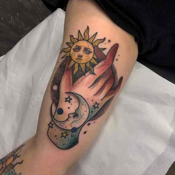 hand-earth-sun-moon-tattoo-bloodflowerstattoo