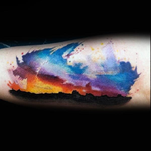 Mens Skyline Silhousette Forearm Tattoo With Dramatic Sunset
