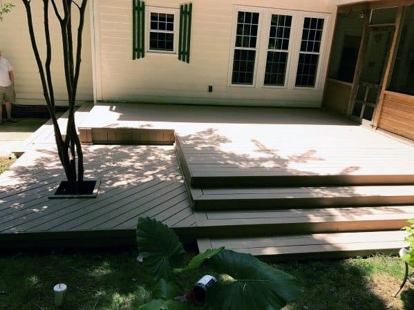 Top 50 Best Deck Steps Ideas Backyard Design Inspiration | Patio With Stairs From House | Residential | Curved Paver | Main Entrance Stamped Concrete Front | Walkout Basement | Decorative