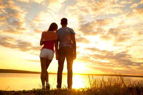 young couple looking sunset