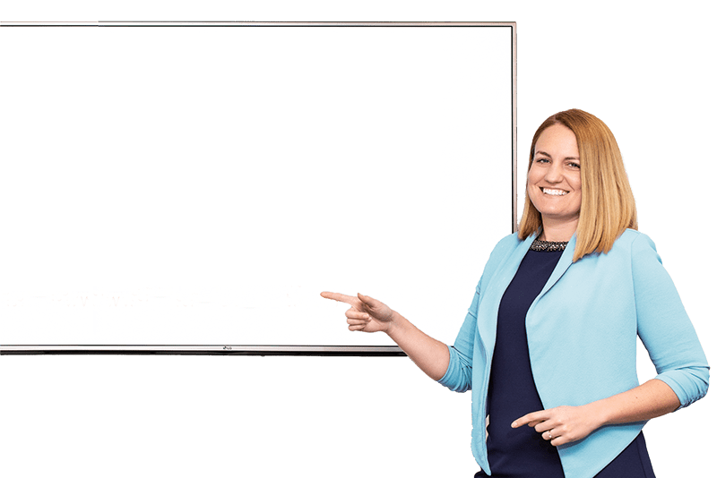 Julie Kratz, inclusive leadership trainer pointing to a whiteboard