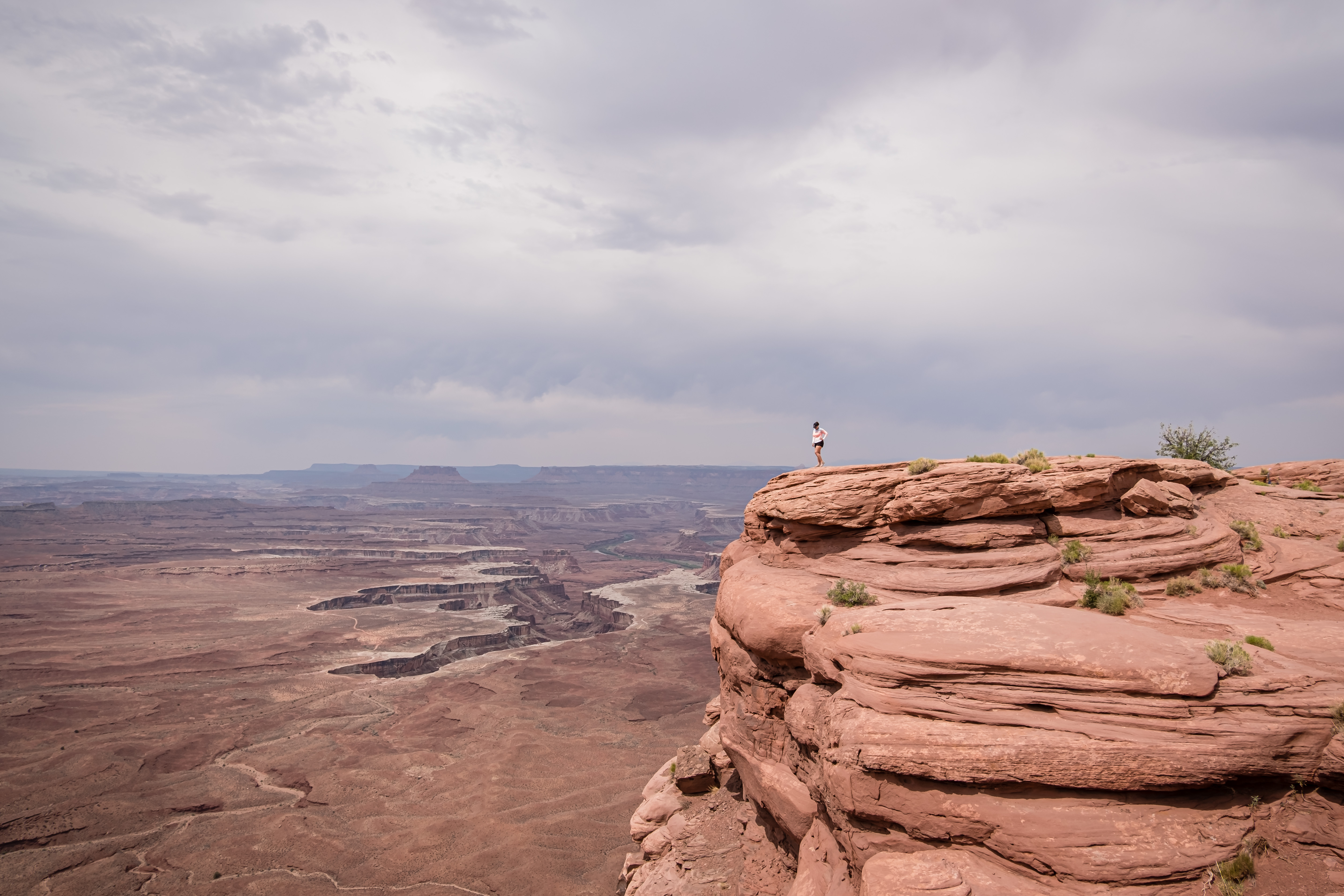 standing on a canyon edge in canyonlands national park