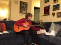 Cute Mama practicing her guitar