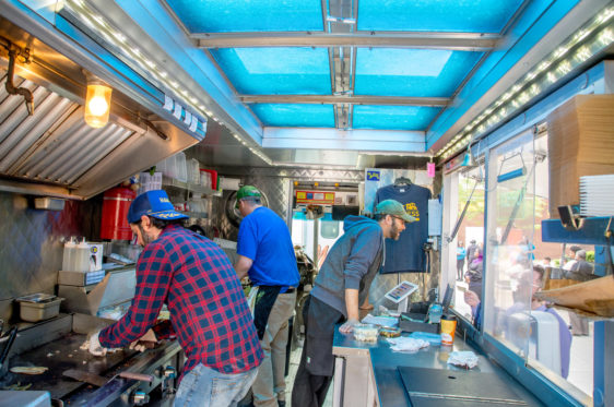 Cooking and taking orders inside a food truck