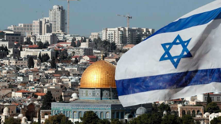 The Israeli flag fluttering in front of the Dome of the Rock mosque and the city of Jerusalem