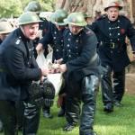 Firemen bring out an injured colleague - John Lee