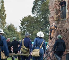 A casualty is lowered from the building in a Neil Robertson rescue stretcher - John Lee