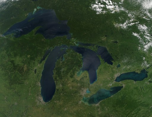 NASA image acquired August 28, 2010 Late August 2010 provided a rare satellite view of a cloudless summer day over the entire Great Lakes region. North Americans trying to sneak in a Labor Day weekend getaway on the lakes were hoping for more of the same. The Great Lakes comprise the largest collective body of fresh water on the planet, containing roughly 18 percent of Earth's supply. Only the polar ice caps contain more fresh water. The region around the Great Lakes basin is home to more than 10 percent of the population of the United States and 25 percent of the population of Canada. Many of those people have tried to escape record heat this summer by visiting the lakes. What they found, according to The Hamilton Spectator, was record-breaking water temperatures fueled by record-breaking air temperatures in the spring and summer. By mid-August, the waters of Lake Superior were 6 to 8°C (11 to 14°F) above normal. Lake Michigan set records at about 4°C (7°F) above normal. The other three Great Lakes – Huron, Erie, and Ontario -- were above normal temperatures, though no records were set. The image was gathered by the Moderate Resolution Imaging Spectroradiometer (MODIS) on NASA's Aqua satellite at 1:30 p.m. Central Daylight Time (18:30 UTC) on August 28. Open water appears blue or nearly black. The pale blue and green swirls near the coasts are likely caused by algae or phytoplankton blooms, or by calcium carbonate (chalk) from the lake floor. The sweltering summer temperatures have produced an unprecedented bloom of toxic blue-green algae in western Lake Erie, according to the Cleveland Plain Dealer. . References . Environmental Protection Agency. (n.d.) The Great Lakes Atlas. Accessed September 3, 2010. . The Cleveland Plain Dealer. (August 22, 2010) Scientists say the toxic blue-green algae will only get worse on Ohio lakes. Accessed September 3, 2010. . The Hamilton Spectator. (August 13, 2010) Great Lakes turn to 'bath water.' Accessed September 3, 2010. NASA image by Jeff Schmaltz, MODIS Rapid Response Team, Goddard Space Flight Center. Caption by Mike Carlowicz. Instrument:  Aqua - MODIS Click here to see more images from NASA Goddard's Earth Observatory NASA Goddard Space Flight Center is home to the nation's largest organization of combined scientists, engineers and technologists that build spacecraft, instruments and new technology to study the Earth, the sun, our solar system, and the universe. Follow us on Twitter Join us on Facebook