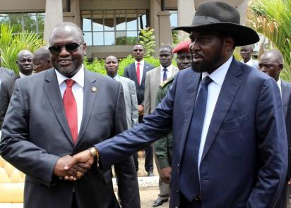 South Sudan President Salva Kiir (R) shaking hands with former rebel leader and First Vice-President Riek Machar (L) after a new unity government was sworn-in, Juba, South Sudan. Reports on 10 July 2016 said hundreds were killed in two days of renewed fighting between supporters of President Salva Kiir and Vice-President Riek Machar. The UN Security Council condemned the fighting that erupted in Juba, the worst violence since a peace deal was signed in 2015 and forming the national unity government in April this year. EPA/PHILLIP DHIL