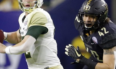 Bears QB Brewer under pressure during the Texas Bowl