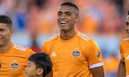 Dynamo Forward Mauro Manotas smiles as the pregame ceremony takes place.