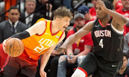 Korver of the Jazz goes against House Jr of the Rockets
