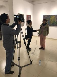 Nguyen Thi Mai, contemporary artist, being interviewed by the media on the occasion of Metamorphosis.