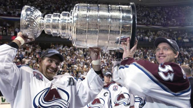 9 Jun 2001: Ray Bourque #77 of the Colorado Avalanche and teammate Patrick Roy #33 raise the Stanley Cup after they beat the New Jersey Devils 3-1 in game seven of the NHL Stanley Cup Finals at Pepsi Center in Denver, Colorado. The Avalanche take the series 4-3. DIGITAL IMAGE. Mandatory Credit: Elsa/Allsport