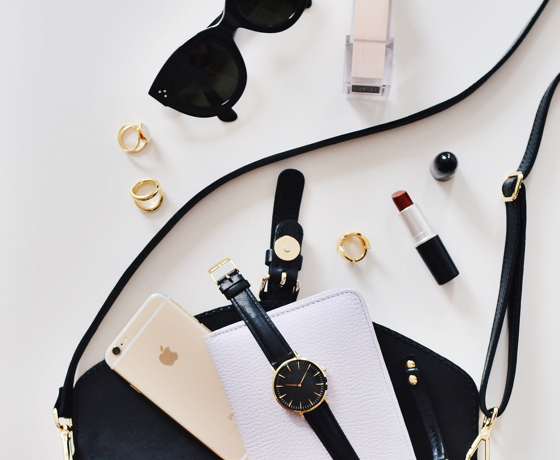 Flatlay of content of woman's handbag