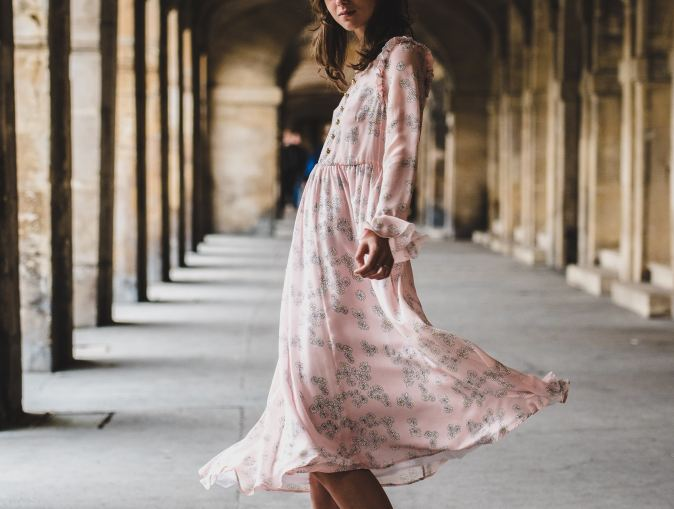 Flaunter.com image of woman in long pink print dress swirling