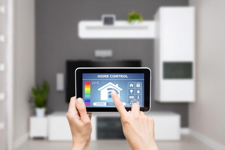 Picture of someone using a tablet to control technology in the home