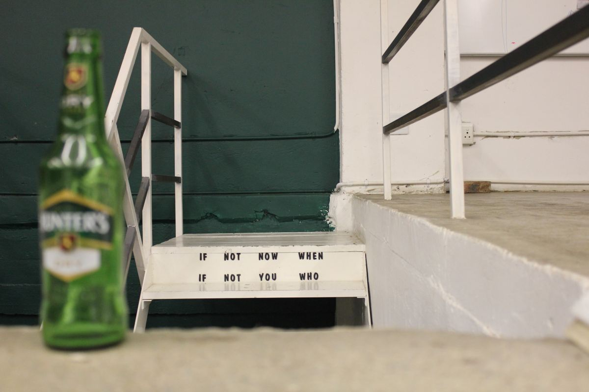 Beach steps with a bottle of beer and quote