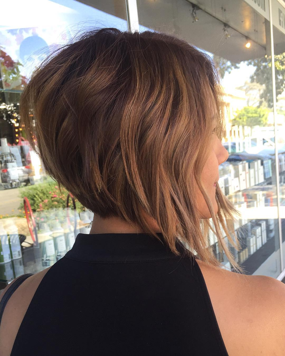 Defined disconnected layers on short straight hairstyle