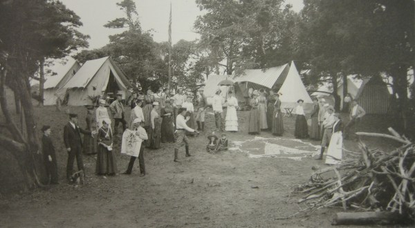 "Photograph 2 – As this photograph makes clear, the annual meetings were ""in tents"" experiences. Although the first campsites were fairly simple affairs, later encampments are more aptly compared to a small village. Adirondack Museum, S.R. Stoddard, ""Squaw-Land,"" Glimpses of the ACA, 1890."
