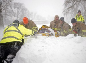 Firefighters, police officers, and paramedics transport a patient over heavy snow. Photo credit: Andrew Vaughan, The Canadian Press. See http://news.nationalpost.com/news/canada/halifax-transit-at-a-standstill-after-storm-dump-50-cm-of-snow-on-the-city