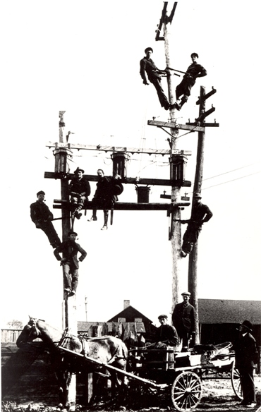 "Photo credit: ""Men working on transformer,"" Thomas Bouckley Collection, Robert McLaughlin Gallery, 1912, TBC 0909."