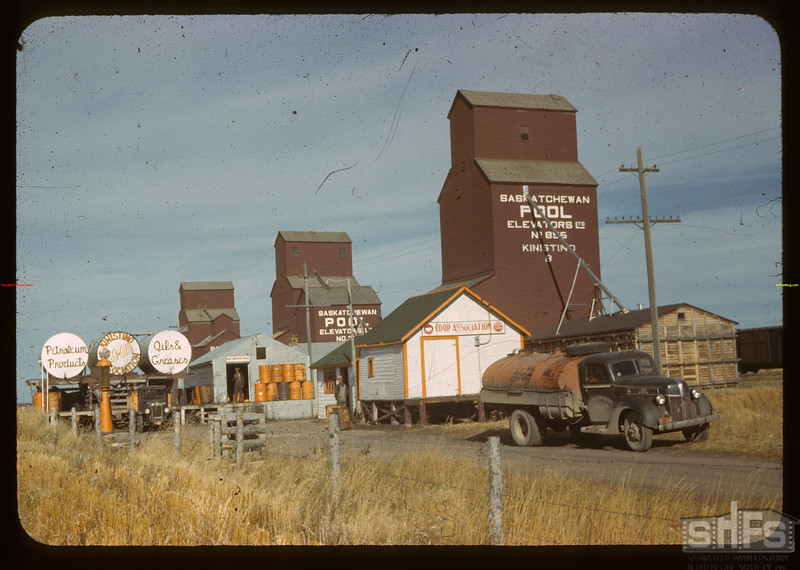 Two pool Elevators fine Co-op Oil Business, Kinistino, Saskatchewan, September 1, 1942. Source: Everett Baker Slides, Saskatchewan History and Folklore Society