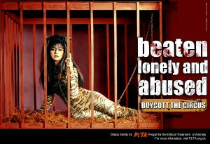 Indian actress Shilpa Shetty poses in a cage for a PETA ad.