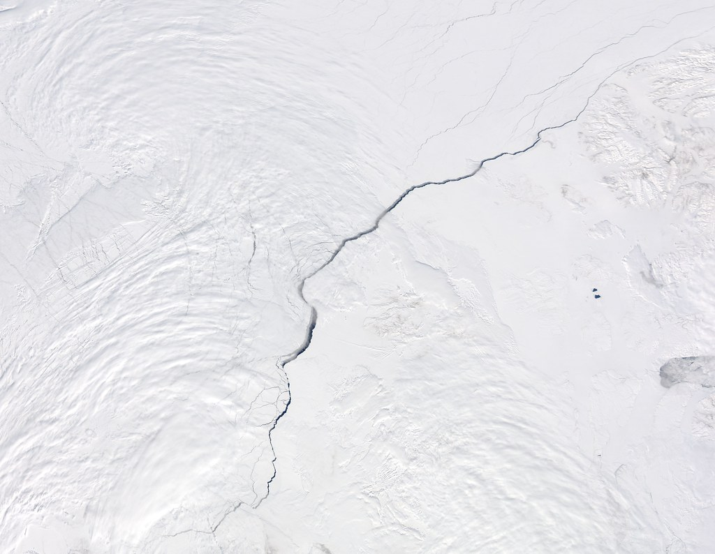 An overhead image of a crack in ice, known as an open water lead, in the Canadian Arctic.