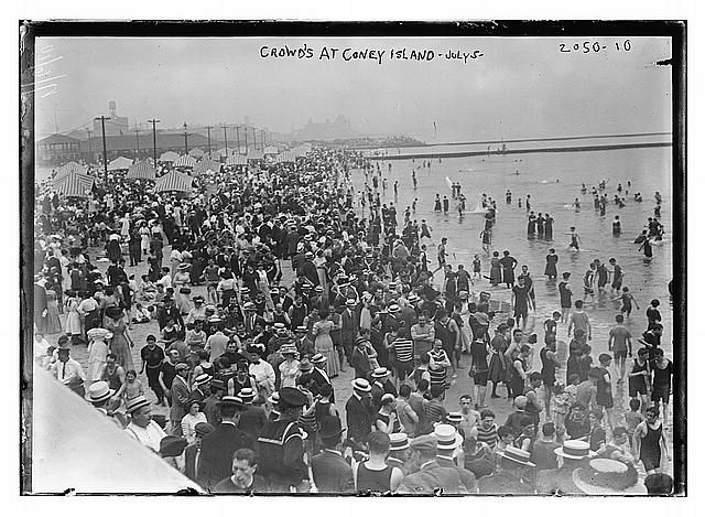 Crowds at Coney Island during a summer heatwave at the turn of the century.