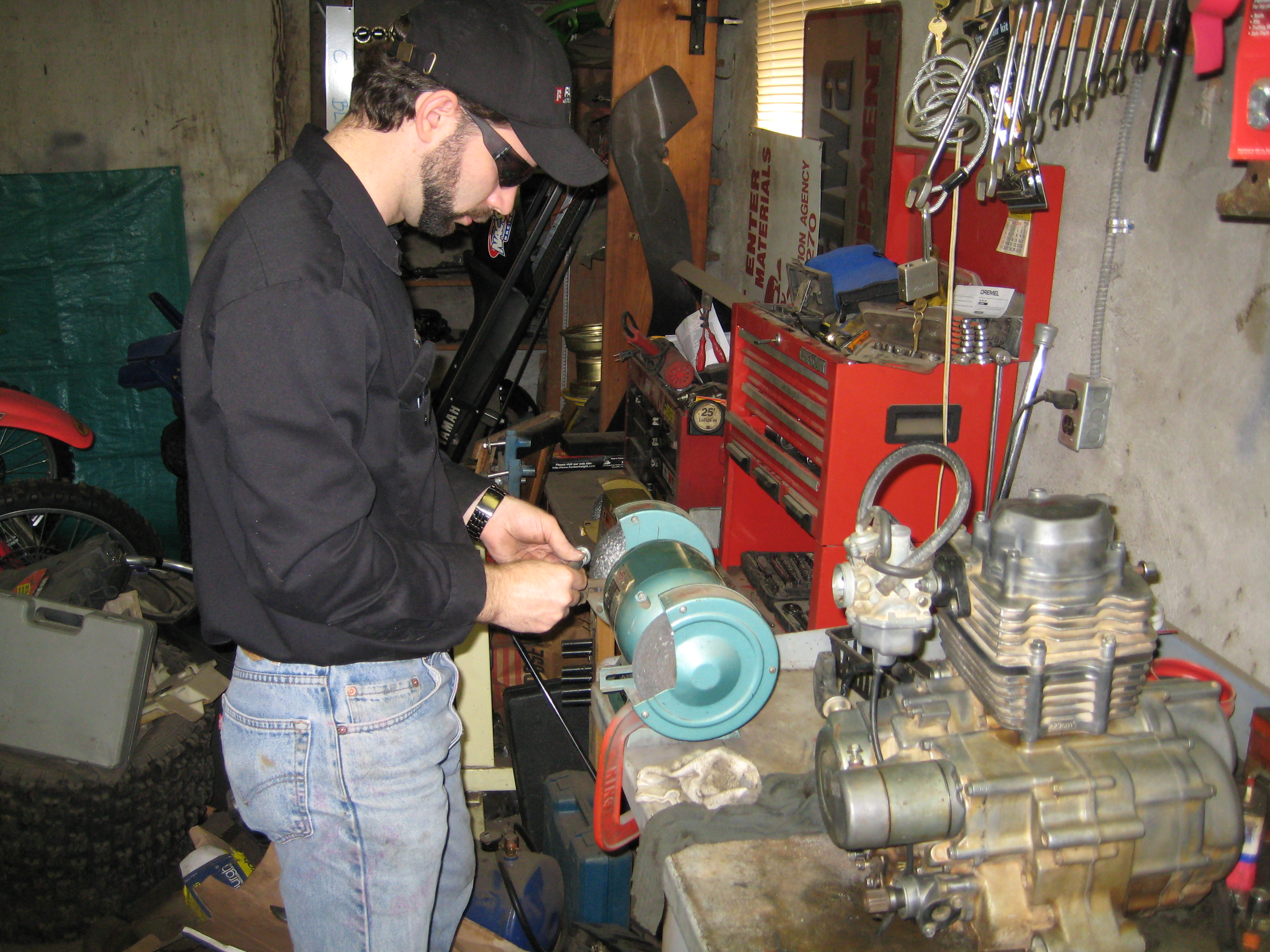 Cleaning the parts with a wire wheel