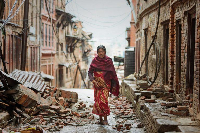Woman waling through rubble, Kathmandu