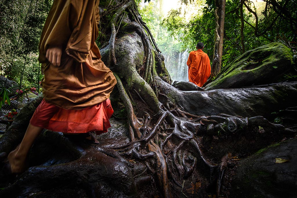 Monks at the Kulen Waterfalls in Cambodia