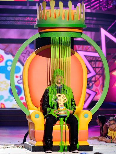 King of Slime|Josh Duhamel takes a seat on his slime throne after winning the Arm Fart Extavaganza.