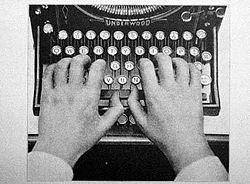 typewriter two hands