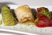 Close-up of Turkish desserts on white plate