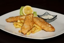 Fish and chips with lemon and sauce